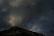 """SHOT 7/16/2006 - A rainbow forms in the late afternoon light in Crested Butte, Co. The historic Town of Crested Butte is a Home Rule Municipality located in Gunnison County, Colorado, United States. A former coal mining town now called """"the last great Colorado ski town"""", Crested Butte is a destination for skiing, mountain biking, and a variety of other outdoor activities.The Colorado General Assembly has designated Crested Butte the wildflower capital of Colorado..(Photo by MARC PISCOTTY / © 2006)"""