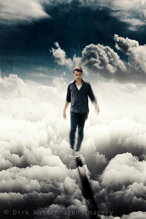 Young man balancing - surreal composite image