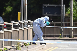 © Licensed to London News Pictures. 22/06/2020. Reading, UK. Police forensics working on the roads surrounding Forbury Gardens in Reading town centre where three people were stabbed to death in a terrorist attack. Several other people were injured in the attack which was carried out by Libyan asylum seeker Khairi Saadallah, who is currently in custody. . Photo credit: Ben Cawthra/LNP