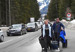 13.03.2020, St. Anton am Arlberg, AUT, Coronavirus in Österreich, Abreise der Urlaubsgäste von St. Anton am Arlberg, Zwei besonders vom Coronavirus betroffene Gebiete in Tirol werden gemäß Beschluss der Bundesregierung für zwei Wochen unter Quarantäne gestellt. Betroffen sind das Paznauntal mit Tourismus-Hotspots wie Ischgl und Galtür sowie St. Anton am Arlberg, im Bild Touristen verlassen St. Anton Arlberg auf den Fußweg // during Two areas in Tyrol that are particularly affected by the corona virus are being quarantined for two weeks according to a decision by the federal government. The Paznaun Valley is affected with tourism hotspots such as Ischgl and Galtür as well as St. Anton am Arlberg. St. Anton am Arlberg, Austria on 2020/03/13. EXPA Pictures © 2020, PhotoCredit: EXPA/ Erich Spiess