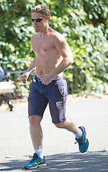 ©Licensed to London News Pictures 13/07/2020     <br /> Greenwich, UK. A man keeping fit with a topless run around the park. Warm sunny weather today as people get out and about in Greenwich park, Greenwich, London. Photo credit: Grant Falvey/LNP