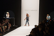 Rebecca Minkow waving to guests and buyers at the end of her Spring 2003 show at Mercedes Benz Fashion Week.