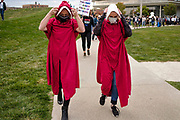 17 OCTOBER 2020 - DES MOINES, IOWA: Women wearing a costumes from the Handmaid's Tale walk to the start of the We Dissent Women's March. About 300 women participated in the We Dissent Women's March in Des Moines. The march was one of several held across the US to protest the confirmation of Amy Coney Barrett to the Supreme Court seat once held by Ruth Bader Ginsburg. The women marched through downtown and passed by the closed offices of US Senators Chuck Grassley and Joni Ernst.         PHOTO BY JACK KURTZ