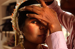 """Gowindra, 19, prepares for her wedding in Nagapattinum district in Tamil Nadu, India  eight months since the deadly tsunami killed thousands August  29, 2005. Both she and her husband's family both lost relatives, their homes and livelihoods in the wave and must live in the temporary shelters after the ceremony. Hundreds of """"tsunami weddings"""" have taken place since December as families received huge amounts of money for their deceased relatives and wished to make allegiances with other families who received money. In India, the girls family must pay a dowry and Gowindra had to pay a staggering 200,000 rupees, nealry $5000 in a community that survives off an average $1 per day.  The recovery process is slow and the situation still grim for many of the worlds poorest who were most affected by the deadly wave.  (Ami Vitale)"""