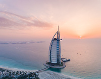 Aerial view of the luxurious Burj Al Arab Hotel at sunset in Dubai, U.A.E.