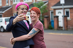 © Licensed to London News Pictures . 10/06/2016 . Manchester , UK . Comedian EDDIE IZZARD (left) meets resident (and fan) RACHEL MORRIS (right) when door knocking in Hulme , Manchester , in support of the Remain campaign , ahead of the UK's EU Referendum . Photo credit : Joel Goodman/LNP