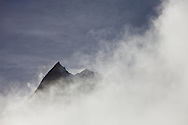 The peak of a mountain showing on a cloudy morning at Annapurna base camp, Annapurna Sanctuary, Nepal