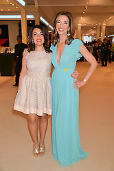 Left to right, NAZY VASSEGH and HEATHER KERZNER at the Masterpiece Marie Curie Party supported by Jeager-LeCoultre held at the South Grounds of The Royal Hospital Chelsea, London on 30th June 2014.