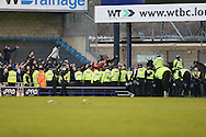 Police hold back the fans after full time. The Emirates FA Cup 5th round match, Millwall v Leicester City at The Den in London on Saturday 18th February 2017.<br /> pic by John Patrick Fletcher, Andrew Orchard sports photography.