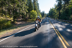 Mark Hill riding his 1936 Indian Four during Stage 16 (142 miles) of the Motorcycle Cannonball Cross-Country Endurance Run, which on this day ran from Yakima to Tacoma, WA, USA. Sunday, September 21, 2014.  Photography ©2014 Michael Lichter.