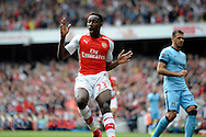 Arsenal's Danny Welbeck reacts after his chip shot hits the post. Barclays Premier league match, Arsenal v Manchester city at the Emirates Stadium in London on Saturday 13th Sept 2014.<br /> pic by John Patrick Fletcher, Andrew Orchard sports photography.