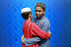 June 26, 2017 - Dhaka, Bangladesh - Bangladeshi children embrace after offering Eid prayers at the start of the Eid al-Fitr holiday marking the end of Ramadan in front of the National Eid Prayer Ground at the High-Court in Dhaka. (Credit Image: © Suvra Kanti Das via ZUMA Wire)