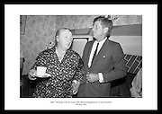 Kennedy in Ireland.  President Kennedy visits the homestead of his great-grandfather at Dunganstown, Co. Wexford and drinks a cup of tea with the present owner of the cottage, a second cousin of the President, Mrs. Mary Ryan (neé Kennedy).<br />