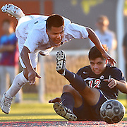 Golden West Rustlers central midfielder Jonathan Canales, left, trips over Orange Coast Pirates defender Estevan Silva during a game at Orange Coast College on Friday, Nov. 7, 2014. The Rustlers defeated the Pirates 1-0. (Timothy Tai/Sports Shooter Academy XI)