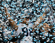 CHARLOTTE, NC - JAN 24:  Tight end Greg Olsen #88 of the Carolina Panthers celebrates during the post game ceremony after the NFC Championship game against the Arizona Cardinals at Bank of America Stadium on January 24, 2016 in Charlotte, North Carolina.