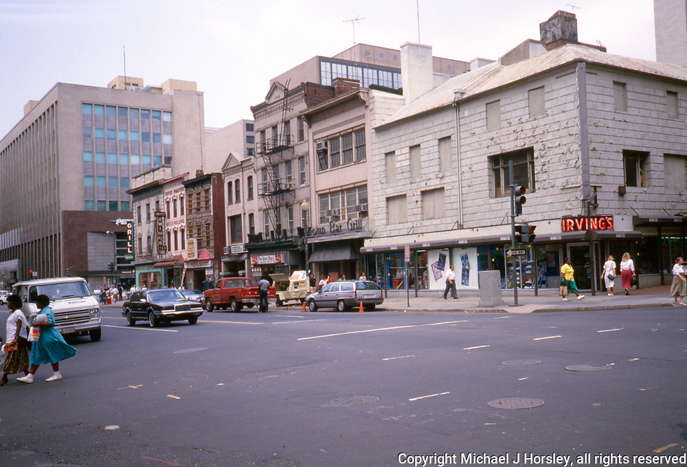 E Street between 11th and 10th NW Washington DC, 1988<br /> Whitlow's Grill, Swing's Coffee, Irving's Sporting Goods, Crown Bar and Grill