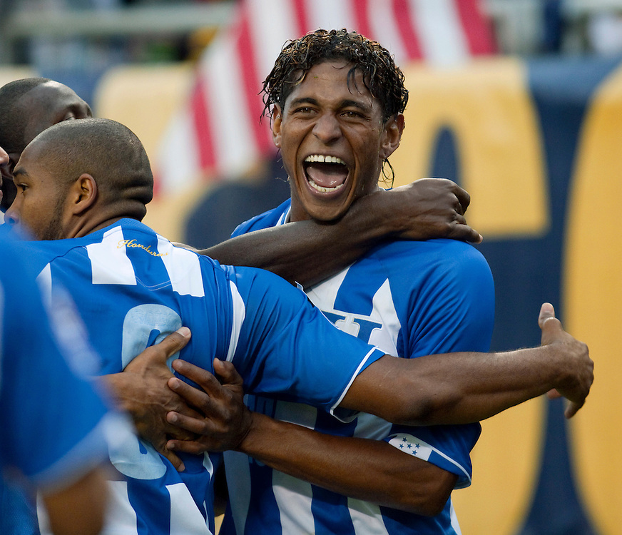 Soccer - FIFA World Cup Qualifier - United States vs Honduras -.Honduras' Carols Costly (13), right, celebrates his goal in the first half with Wilson Palacios (8) and other teammates at Soldier Field in Chicago.