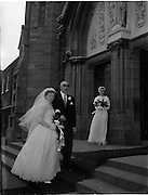 18/02/1957<br /> 02/18/1957<br /> 18 February 1957<br /> Wedding Dr K. Murphy and J. Fitzgerald at St. Mary's Church, Haddington Road and reception at Salthill Hotel, Monkstown. Bride being escorted into church by her father.