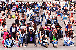 © licensed to London News Pictures. LONDON, UK  19/04/2011. Tourists and Londoners  sitting on the steps in Trafalgar Square enjoy the sun on the hottest day of the year so far. The warm weather is expected to last through the Easter weekend. Please see special instructions for usage rates. Photo credit should read CLIFF HIDE/LNP