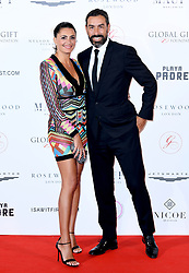 Robert Pires (right) and Jessica Lemarie attending the Nelson Mandela Global Gift Gala, at the Rosewood Hotel, London. Photo credit should read: Doug Peters/EMPICS Entertainment