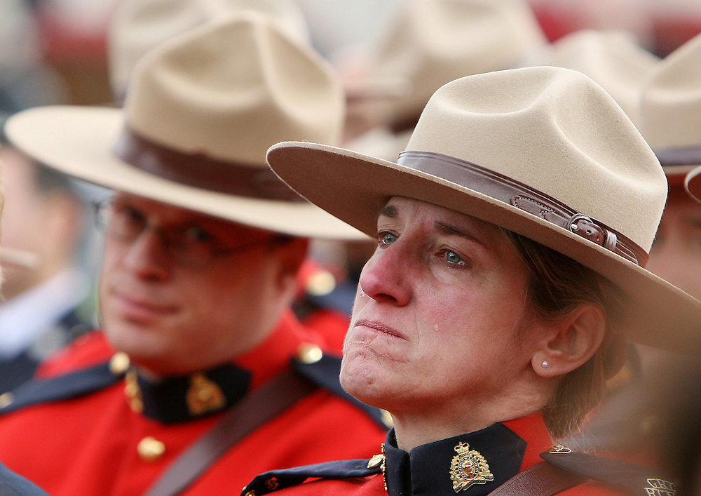 RCMP Sgt. Lise Lachance of Ottawa sheds a tear as she watches an outside broadcast of the funeral of Constable Christopher Worden in Ottawa on Monday Oct 15, 2007. Worden was killed in Hay River, N.W.T, on Oct. 6. .THE CANADIAN PRESS