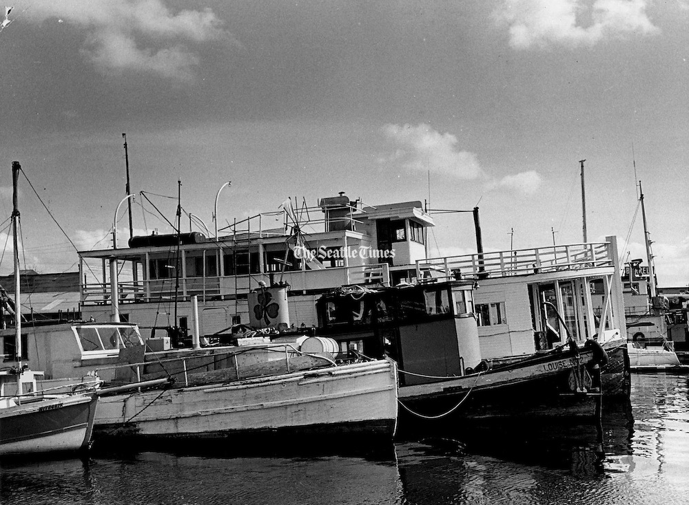 """This flotilla of vintage boats on Lake Union is sometimes referred to as """"Skeet's Fleet,"""" after Skeet Kelley, who makes his home in the small tug. (Roy Scully / The Seattle Times, 1973)"""