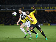 Watford's M'Baye Niang tussles with WBA's Gareth McAuley during the Premier League match at Vicarage Road Stadium, London. Picture date: April 4th, 2017. Pic credit should read: David Klein/Sportimage