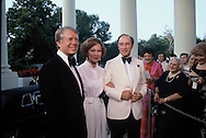 President Jimmy Carter welcomes Canadian Prime Minister Pierre Trudeau at the North Portico of the White House for a dinner of heads of state of NATO on Mary 30, 1978<br /> Photo by Dennis Brack
