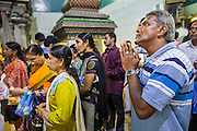 22 DECEMBER 2012 - SINGAPORE, SINGAPORE:   People pray at Sri Veeramakaliamman Temple, a Hindu temple located in Little India in Singapore. The Sri Veeramakaliamman Temple is dedicated to the Hindu goddess Kali, fierce embodiment of Shakti and the god Shiva's wife, Parvati. Kali has always been popular in Bengal, the birthplace of the labourers who built this temple in 1881. Images of Kali within the temple show her wearing a garland of skulls and ripping out the insides of her victims, and Kali sharing more peaceful family moments with her sons Ganesha and Murugan. The building is constructed in the style of South Indian Tamil temples common in Tamil Nadu as opposed to the style of Northeastern Indian Kali temples in Bengal.     PHOTO BY JACK KURTZ