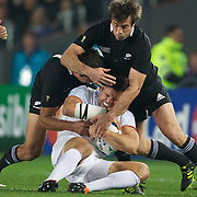 Damien Traille, France is tackled by Richard Kahui, and Conrad Smith, New Zealand (right)  during the New Zealand V France, Pool A match during the IRB Rugby World Cup tournament. Eden Park, Auckland, New Zealand, 24th September 2011. Photo Tim Clayton...