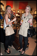 LILY GRAY & TESSA CLARK  (L to R) at the preview of LAPADA Art and Antiques Fair. Berkeley Sq. London. 23 September 2014.