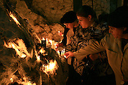 Israel, Mount Meron, Religious women are lightning candles at the Hillula (a celebration day) for Rabbi Simeon bar Yohai at Lag Baomer in Meron mountain, near Tzefat, the burial place of Rabbi Simeon bar Yochai and his son, Rabbi Eleazar ben Simon. hundred of thousands of people come each year to celebrate with lighting fires, candles, singing and feasting. On May 22, 2008.