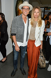OLIVER PROUDLOCK and EMMA LOUISE CONNOLLY at a private view of woks by German artist Mike Dargas held at the Opera Gallery, 134 New Bond Street, London on 5th July 2016.
