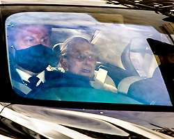 © Licensed to London News Pictures. 16/03/2021. London, UK. Prince Phillip is driven from King Edward VII's Hospital in central London where he has been recovering following a heart procedure.  Photo credit: George Cracknell Wright/LNP