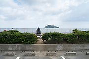 person looking out over Tokyo Bay and Sarushima Island at Umikaze park Yokosuka
