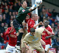 Photo: Dave Linney.<br />Walsall v Bristol City. Coca Cola League 1. 08/04/2006.<br />Bristol's Adriano Basso punches clear off the head of   James Constable