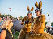 Performers on bouncing stilts entertain festival goers - The 2019 Glastonbury Festival, Worthy Farm. Glastonbury, 27 June 2019
