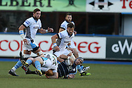 Tom James of Cardiff Blues is hauled down by Nick Grigg of Glasgow. Guinness Pro12 rugby match, Cardiff Blues v Glasgow Warriors Rugby at the Cardiff Arms Park in Cardiff, South Wales on Friday 16th September 2016.<br /> pic by Andrew Orchard, Andrew Orchard sports photography.