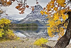 Fall colors and Mt. Sinopah at Upper Two Medicine Lake in Glacier National Park.