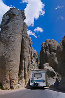 Motor home squeezing through a section of the Needles Highway in Custer State Park in the Black Hills of South Dakota, USA