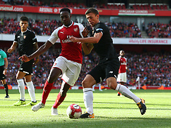 July 30, 2017 - London, England, United Kingdom - Clement Lenglet of Sevilla FC holds of Arsenal's Danny Welbeck..during Emirates Cup match between Arsenal  against Savilla FC   at The Emirates Stadium in north London on July 30, 2017, the game is one of four matches played over two days for the Emirates Cup. (Credit Image: © Kieran Galvin/NurPhoto via ZUMA Press)
