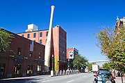 The Louisville Slugger baseball bat factory and museum producing wooden baseball bats - exterior day with large bat at Louisville, Kentucky, USA
