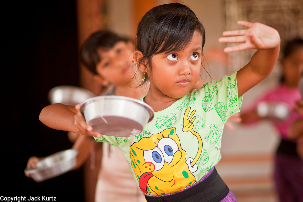 Apr. 25 -- UBUD, BALI, INDONESIA:  Girls practice traditional Balinese dance in the Royal Palace in Ubud, Bali, Indonesia, Sunday, Apr. 25. Most of Indonesia is Muslim but Bali is predominantly Hindu and maintains its Hindu cultures and traditions.    PHOTO BY JACK KURTZ
