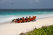 A rubber dinghy boat lands on a beach of Aride Island, Seychelles. Aride Island is the northernmost granitic island in the Seychelles (Bird Island is the northernmost Seychelles island overall). A nature reserve, it is leased and managed by the Island Conservation Society of Seychelles