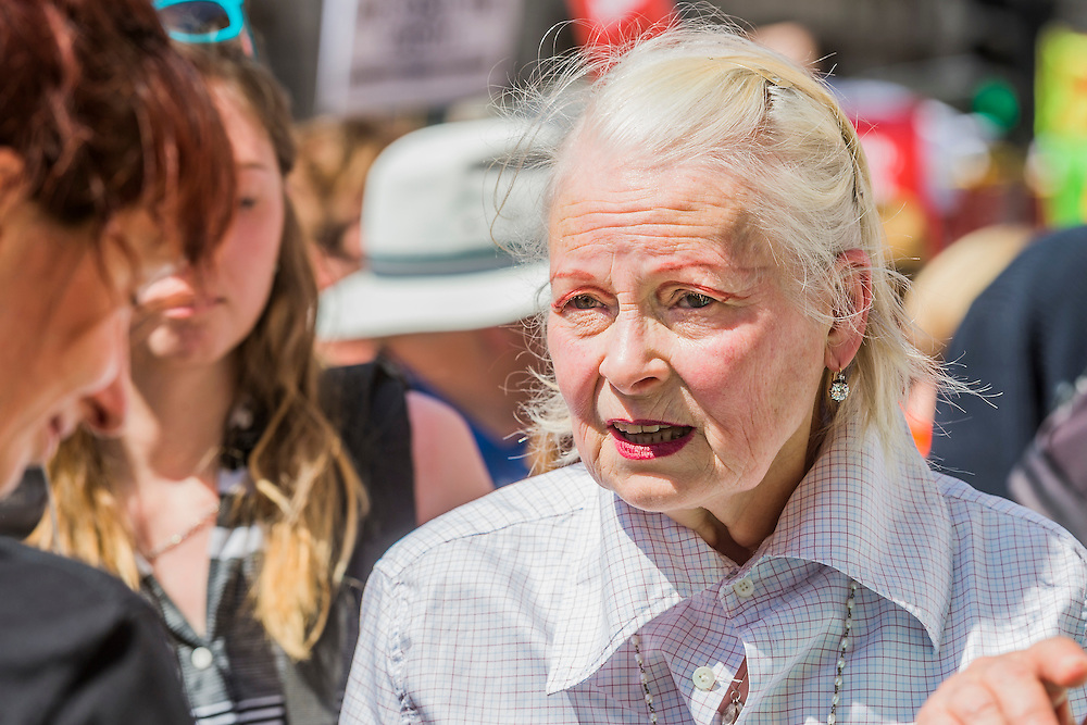 Vivienne Westwood - A perfect summers day for the Campaign against Climate Change's backwards march – on the governments first anniversary in power the protestestors  wanted to highlight their belief that clean energy technology has been sidelined in favour of a 'dash for gas, insulation cut and fracking, roads and runways pushed through despite strong local opposition'. They walked backwards from Traflagar Square, down Whitehall, ending at the DoH.