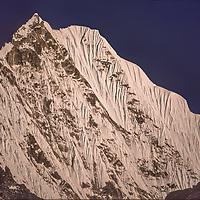 Mount Thamserku overlooks the Dudh Kosi the Khumbu Region in Nepal.