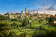 The 13th century medieval wall and towers of San Gimignano. Originally San Gimignano had  70 towers built for protection as a result of feuding families who supported the opposing Guelphs and Ghibellines. Today 12 survive in San Gimignano creating what is called the medieval Manhattan. A UNESCO World Heritage Sites. San Gimignano, Tuscany Italy .<br /> <br /> Visit our ITALY PHOTO COLLECTION for more   photos of Italy to download or buy as prints https://funkystock.photoshelter.com/gallery-collection/2b-Pictures-Images-of-Italy-Photos-of-Italian-Historic-Landmark-Sites/C0000qxA2zGFjd_k<br /> If you prefer to buy from our ALAMY PHOTO LIBRARY  Collection visit : https://www.alamy.com/portfolio/paul-williams-funkystock/sangimignano.html