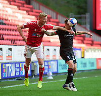 Lincoln City's Harry Anderson vies for possession with Charlton Athletic's Jayden Stockley<br /> <br /> Photographer Andrew Vaughan/CameraSport<br /> <br /> The EFL Sky Bet League One - Charlton Athletic v Lincoln City - Tuesday 4th May 2021 - The Valley - London <br /> <br /> World Copyright © 2021 CameraSport. All rights reserved. 43 Linden Ave. Countesthorpe. Leicester. England. LE8 5PG - Tel: +44 (0) 116 277 4147 - admin@camerasport.com - www.camerasport.com