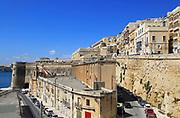 Historic waterfront buildings on Grand Harbour waterside, Valletta, Malta