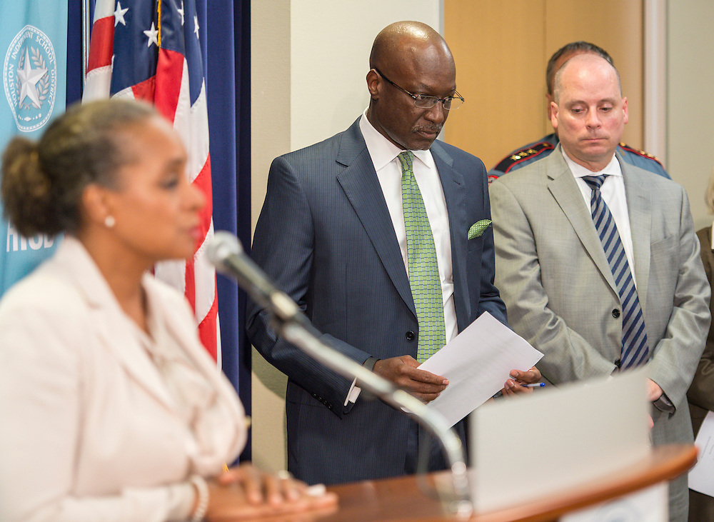 Houston ISD Deputy Superintendent Ken Hewitt, center, and transportation manager Nathan Graf, right, listen as Board of Trustees president Rhonda Skillern-Jones comments during a a news briefing on a bus accident that resulted in the deaths of two students, September 15, 2015.